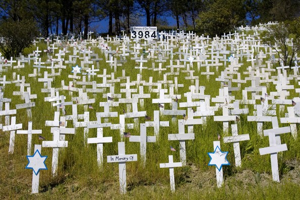 White Crosses Adorn Hillside Memorial Iraq